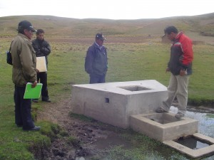 Our staff and Jankoaqui villagers examining a previous water installation.